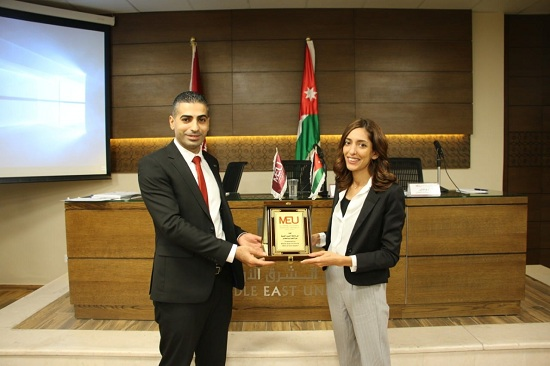 Nour Shalabi from Labiba receives an award from middle east university.jpg
